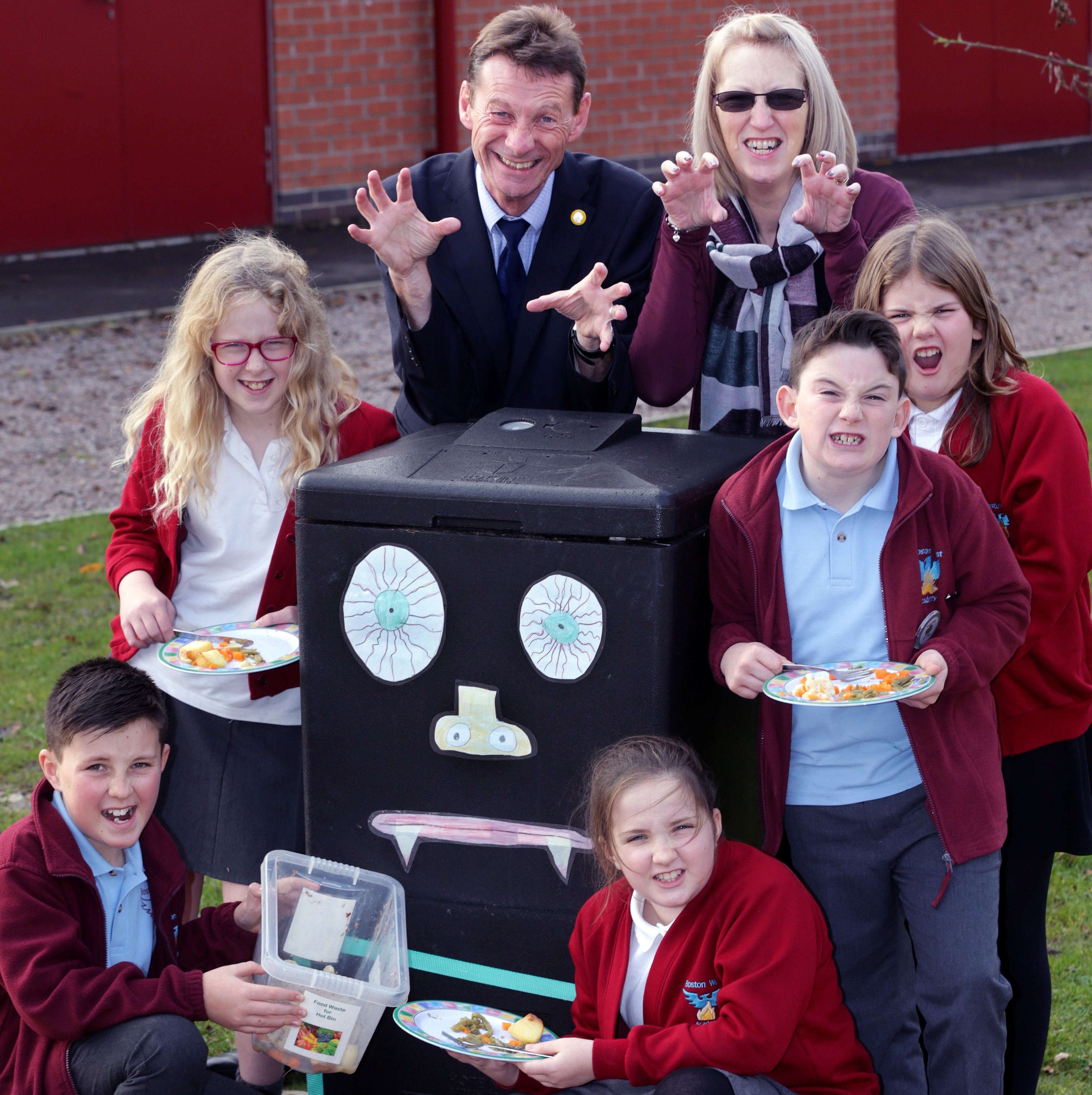 Boston West Primary School shows off its Composter Monster: Eco Club Leader Shirley Chain and Headteacher Mike Schofield with, front, from left, Oliver (11), Megan (11); middle - Hannah (10), Reece (10) and Evie (11)